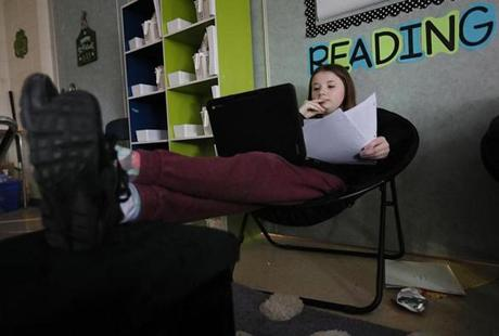 Kallyn Lavalle, 12, studied for a test with her feet up at the Nettle Middle School.